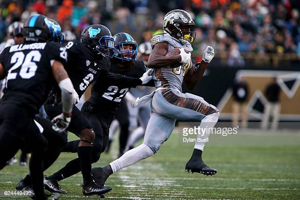 Corey Davis of the Western Michigan Broncos runs with the ball in the second quarter against the Buffalo Bulls at Waldo Stadium on November 19 2016...