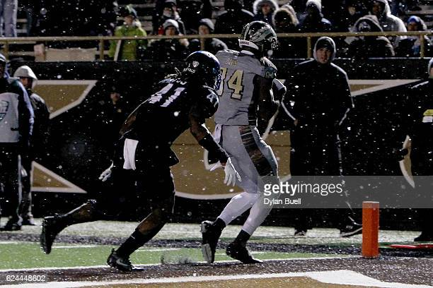 Corey Davis of the Western Michigan Broncos scores a touchdown past Boise Ross of the Buffalo Bulls in the fourth quarter at Waldo Stadium on...
