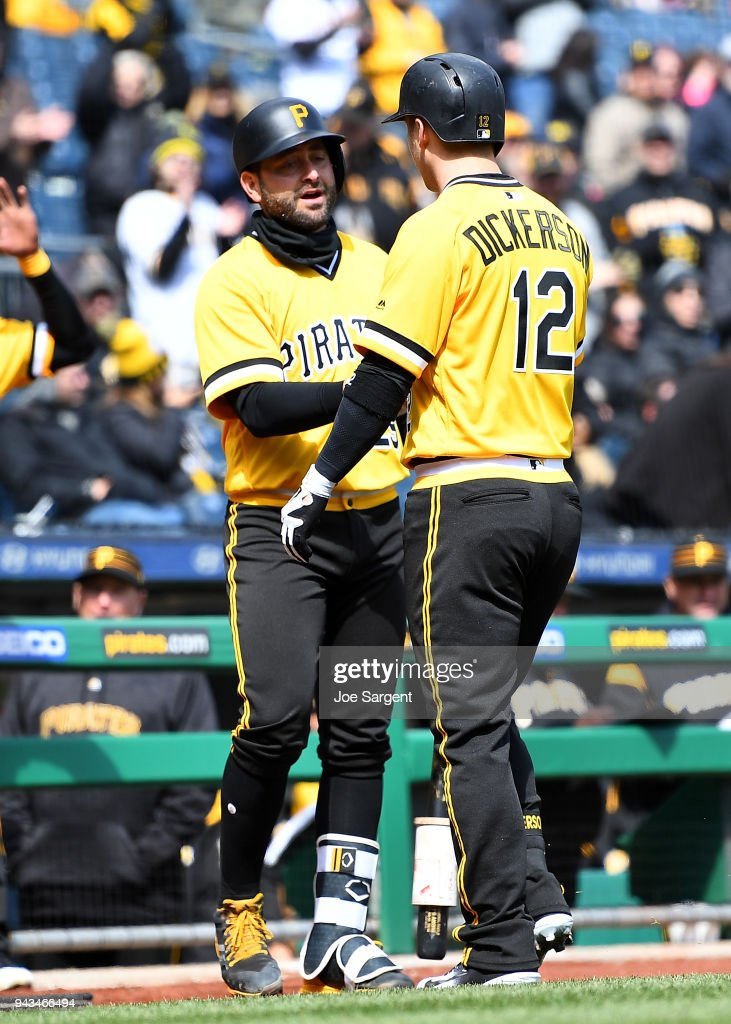 Corey Dickerson #12 celebrates his solo home run with Francisco Cervelli #29 of the Pittsburgh Pirates during the fifth inning agains the Cincinnati Reds at PNC Park on April 8, 2018 in Pittsburgh, Pennsylvania.