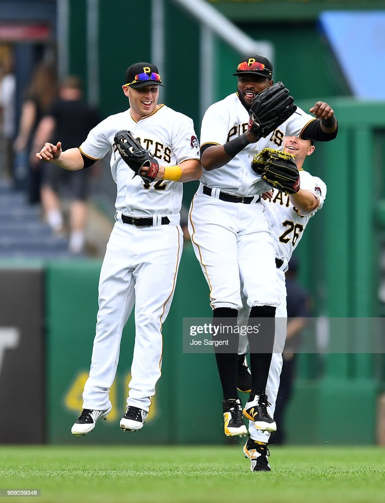 Corey Dickerson #12, Gregory Polanco #25 and Adam Frazier #26 of the Pittsburgh Pirates celebrate after a 3-2 win over the Chicago White Sox during inter-league play at PNC Park on May 16, 2018 in Pittsburgh, Pennsylvania.