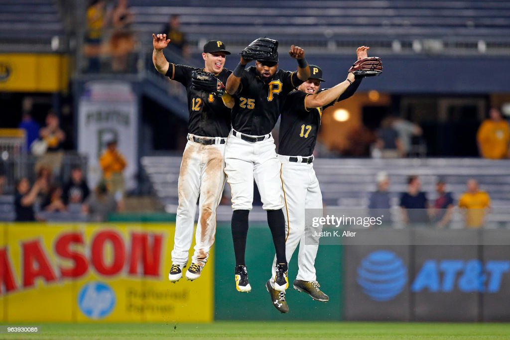 Corey Dickerson #12, Gregory Polanco #25 and Austin Meadows #17 of the Pittsburgh Pirates celebrate after defeating the Chicago Cubs 2-1 at PNC Park on May 30, 2018 in Pittsburgh, Pennsylvania.