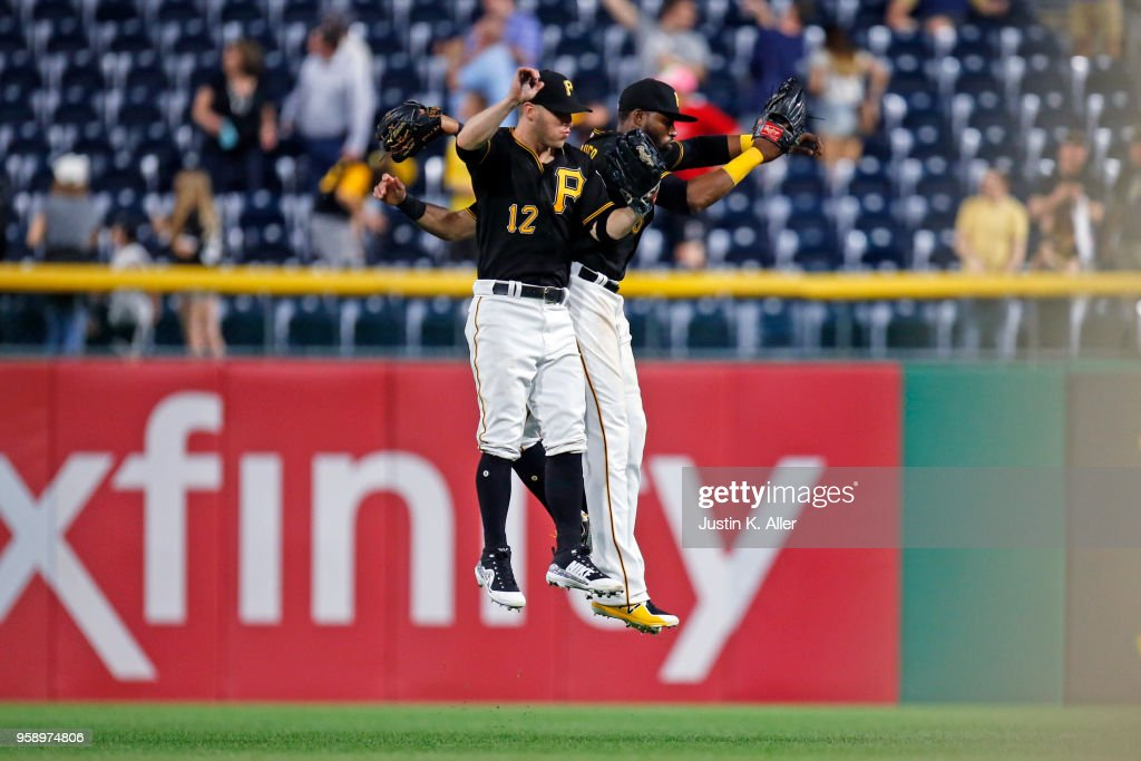 Corey Dickerson #12, Gregory Polanco #25 and Sean Rodriguez #3 of the Pittsburgh Pirates celebrate after defeating the Chicago White Sox 7-0 during inter-league play at PNC Park on May 15, 2018 in Pittsburgh, Pennsylvania.
