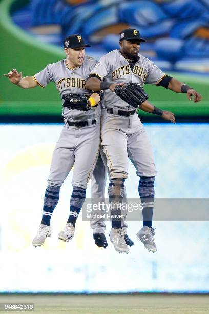 Corey Dickerson Gregory Polanco and Starling Marte of the Pittsburgh Pirates celebrate after defeating the Miami Marlins 73 at Marlins Park on April...