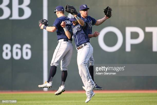 Corey Dickerson Kevin Kiermaier and Peter Bourjos of the Tampa Bay Rays react after a victory over the Boston Red Sox at Fenway Park on September 10...