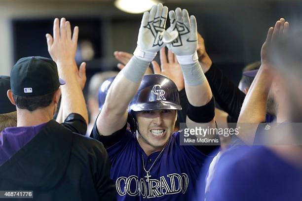 Corey Dickerson of the Colorado Rockies celebrates after hitting a two run homer in the top of the first inning against the Milwaukee Brewers during...