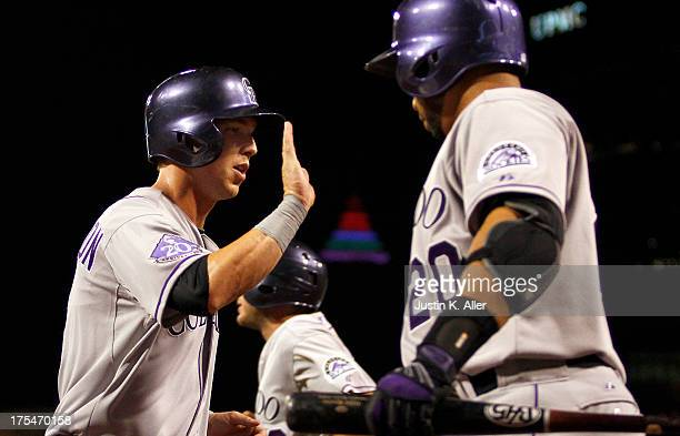 Corey Dickerson of the Colorado Rockies celebrates after scoring on an RBI single in the eighth inning against the Pittsburgh Pirates during the game...