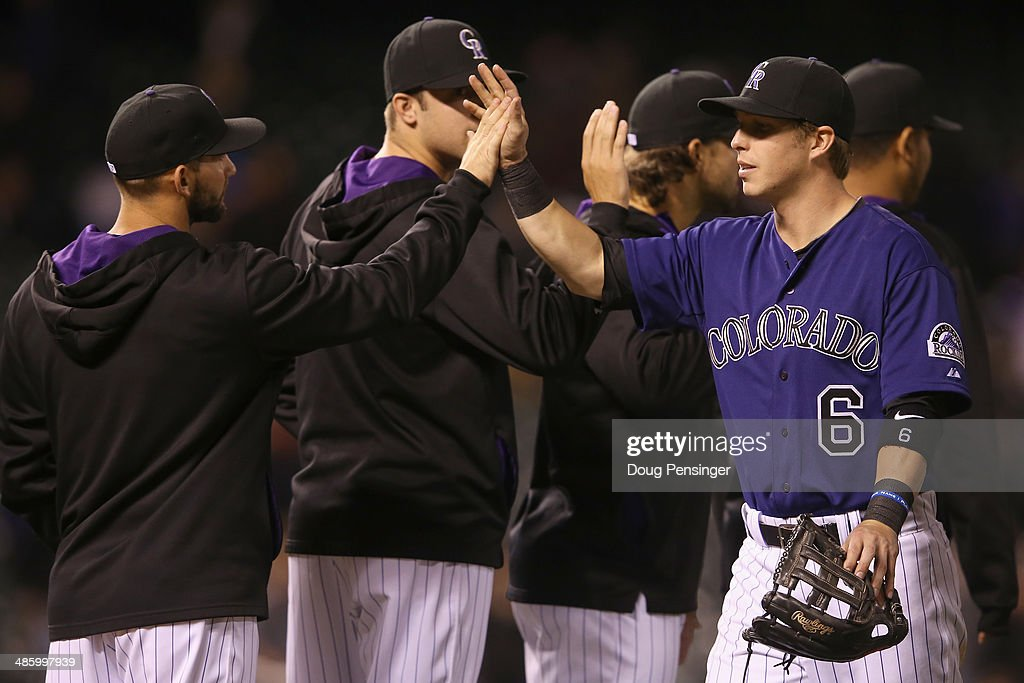 Corey Dickerson #6 of the Colorado Rockies celebrates with his teammates after defeating the San Francisco Giants 8-2 at Coors Field on April 21, 2014 in Denver, Colorado.