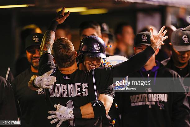Corey Dickerson of the Colorado Rockies is congratulated by teammate Brandon Barnes after tying the game in the bottom of the 9th inning with a home...