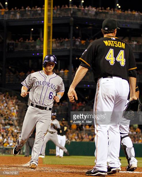 Corey Dickerson of the Colorado Rockies scores on an RBI single in the eighth inning against the Pittsburgh Pirates during the game on August 3 2013...