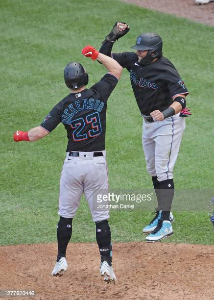 Corey Dickerson of the Miami Marlins celebrates with Miguel Rojas after hitting a three run home run in the 7th inning against the Chicago Cubs...