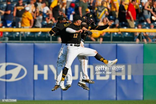 Corey Dickerson of the Pittsburgh Pirates Austin Meadows of the Pittsburgh Pirates and Starling Marte of the Pittsburgh Pirates celebrates after...