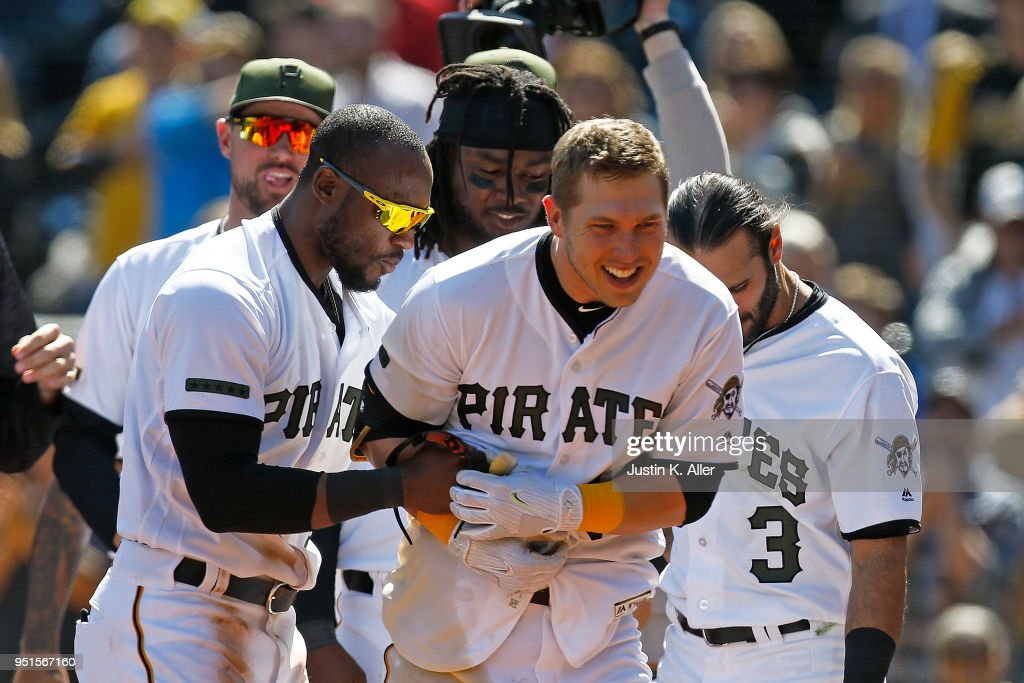 Corey Dickerson #12 of the Pittsburgh Pirates celebrates after hitting a walk off home run in the ninth inning against the Detroit Tigers during interleague play at PNC Park on April 26, 2018 in Pittsburgh, Pennsylvania.