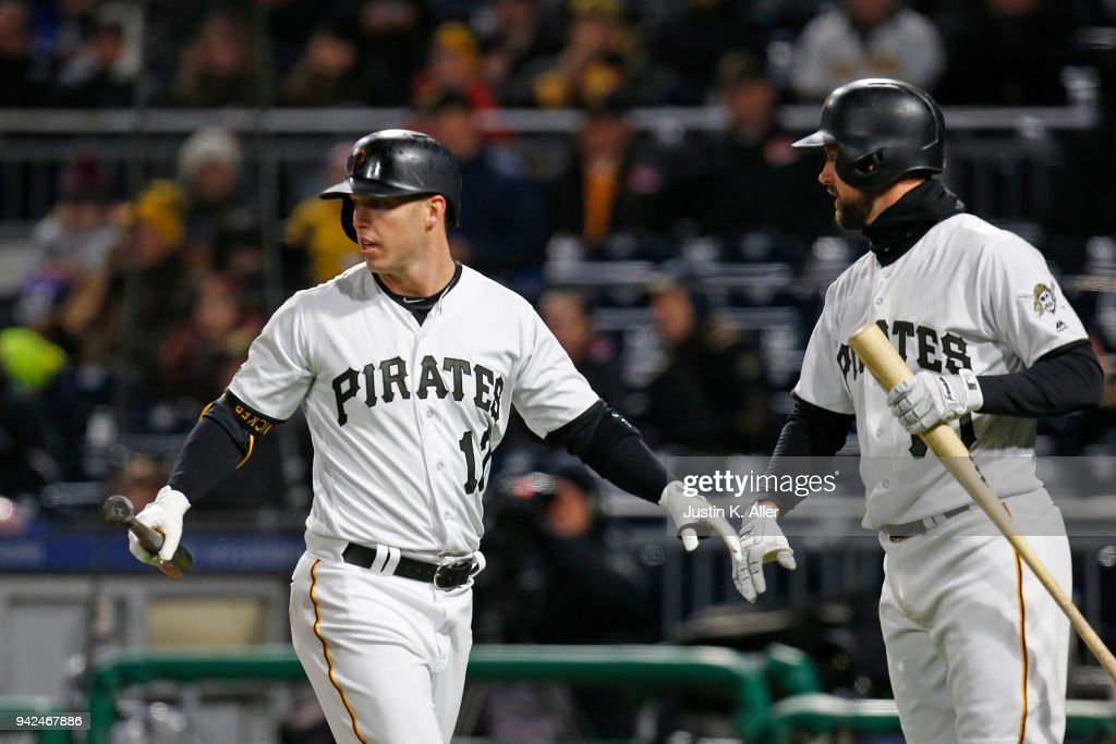 Corey Dickerson #12 of the Pittsburgh Pirates celebrates after scoring on a fielding error in the fifth inning against the Cincinnati Reds at PNC Park on April 5, 2018 in Pittsburgh, Pennsylvania.
