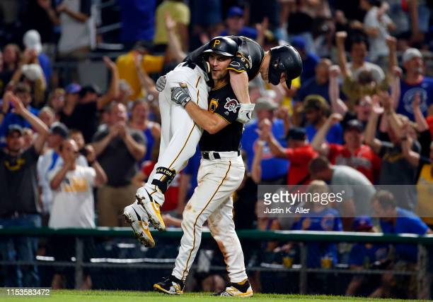 Corey Dickerson of the Pittsburgh Pirates celebrates with Adam Frazier of the Pittsburgh Pirates after hitting the gaem winning sacrifice fly in the...