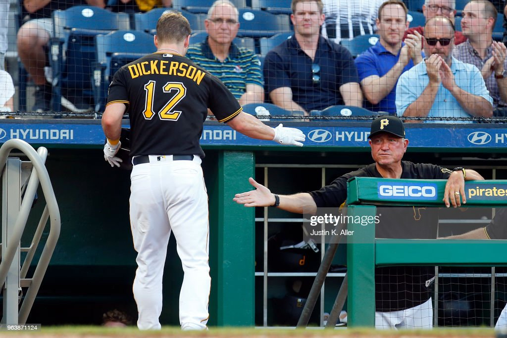 Corey Dickerson #12 of the Pittsburgh Pirates celebrates with manager Clint Hurdle #13 after scoring on a sacrifice fly against the Chicago Cubs at PNC Park on May 30, 2018 in Pittsburgh, Pennsylvania.