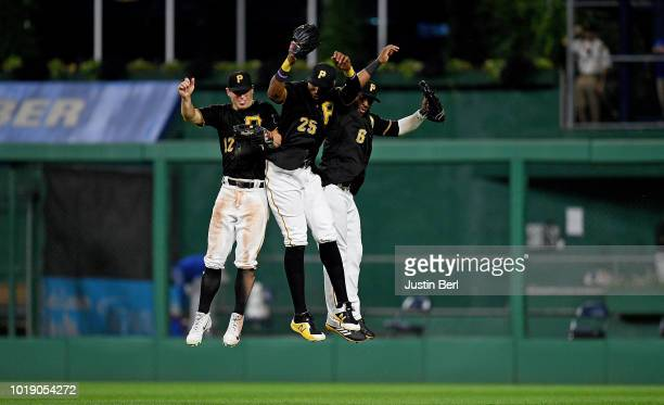 Corey Dickerson of the Pittsburgh Pirates celebrates with Starling Marte and Gregory Polanco after the final out in a 31 win over the Chicago Cubs at...