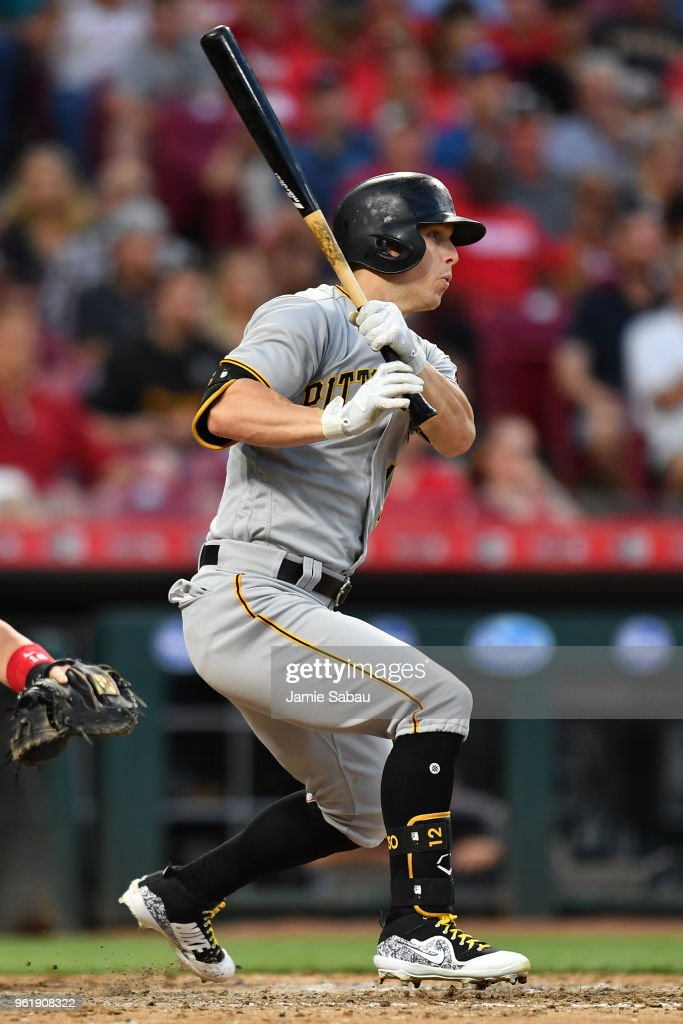 Corey Dickerson #12 of the Pittsburgh Pirates hits an RBI single in the fifth inning against the Cincinnati Reds at Great American Ball Park on May 23, 2018 in Cincinnati, Ohio. Pittsburgh defeated Cincinnati 5-4 in 12 innings.