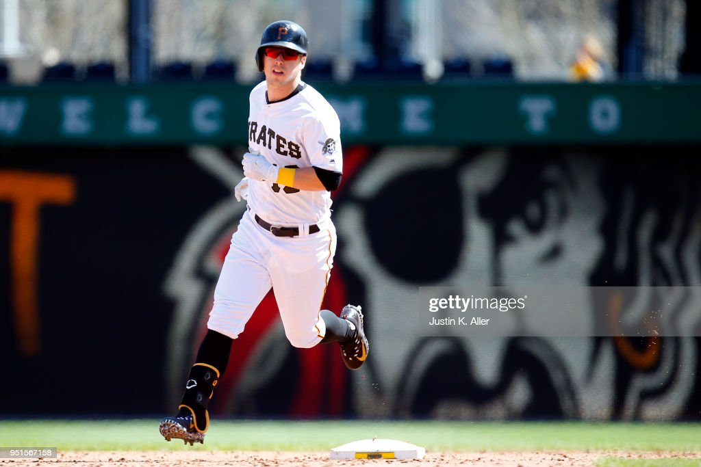 Corey Dickerson #12 of the Pittsburgh Pirates rounds second after hitting a walk off home run in the ninth inning against the Detroit Tigers during interleague play at PNC Park on April 26, 2018 in Pittsburgh, Pennsylvania.