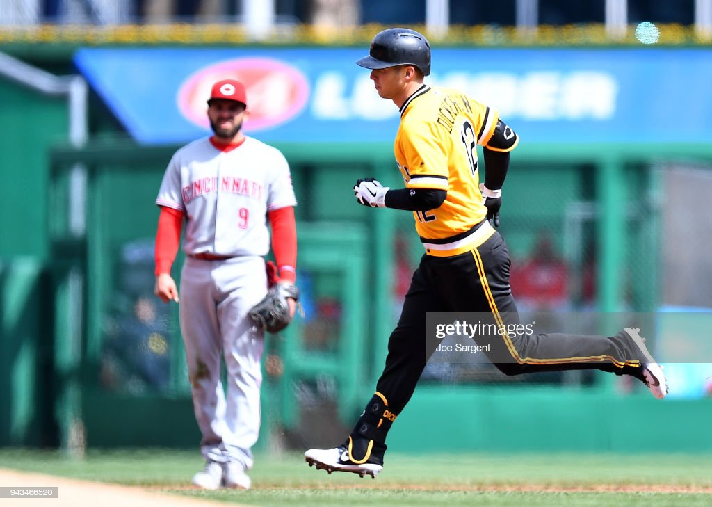 Corey Dickerson #12 of the Pittsburgh Pirates rounds the bases after hitting a solo home run during the fifth inning against the Cincinnati Reds at PNC Park on April 8, 2018 in Pittsburgh, Pennsylvania.