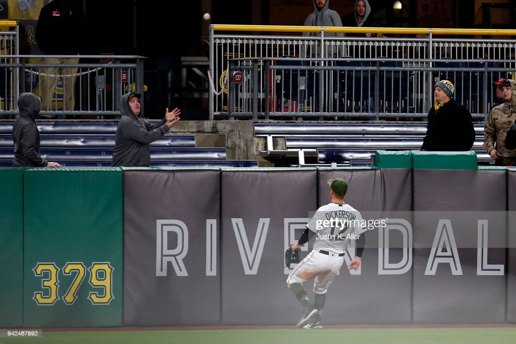 Corey Dickerson #12 of the Pittsburgh Pirates watches a home run clear the wall in the eighth inning against the Cincinnati Reds at PNC Park on April 5, 2018 in Pittsburgh, Pennsylvania.