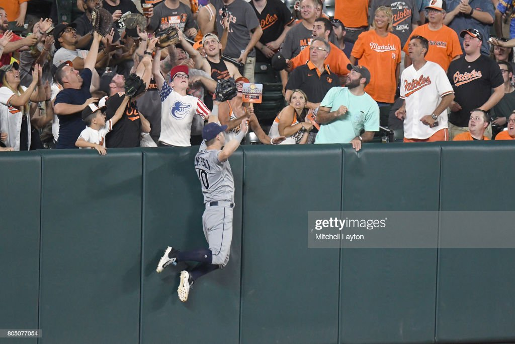 Corey Dickerson #10 of the Tampa Bay Rays can not get to Joey Rickard #23 (not pictured) of the Baltimore Orioles in the sixth inning during a baseball game at Oriole Park at Camden Yards on June 30, 2017 in Baltimore, Maryland.