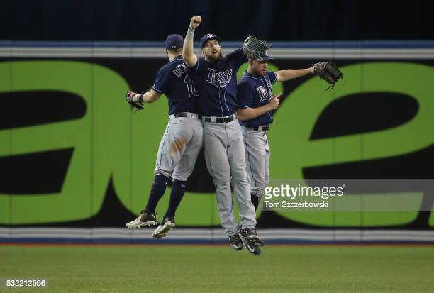 Corey Dickerson of the Tampa Bay Rays celebrates a victory with Steven Souza Jr #20 and Peter Bourjos after MLB game action against the Toronto Blue...