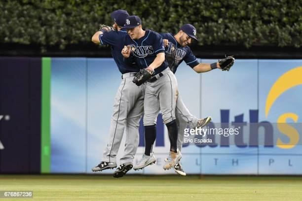 Corey Dickerson of the Tampa Bay Rays celebrates with Kevin Kiermaier and Steven Souza Jr #20 after defeating the Miami Marlins at Marlins Park on...