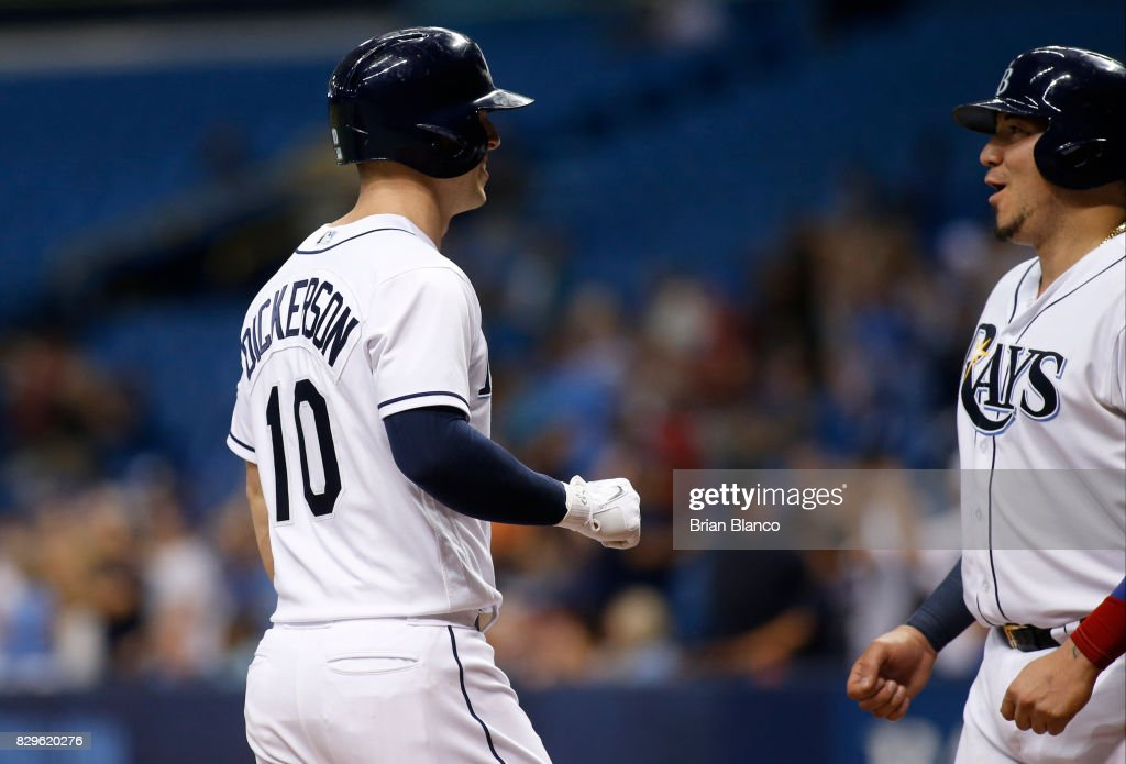 Corey Dickerson #10 of the Tampa Bay Rays celebrates with teammate Jesus Sucre #45 after hitting a three-run home run off of pitcher Nick Goody of the Cleveland Indians during the eighth inning of a game on August 10, 2017 at Tropicana Field in St. Petersburg, Florida.
