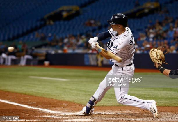 Corey Dickerson of the Tampa Bay Rays hits a threerun home run off of pitcher Nick Goody of the Cleveland Indians during the eighth inning of a game...