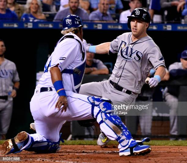 Corey Dickerson of the Tampa Bay Rays is tagged out by Salvador Perez of the Kansas City Royals as tries to score in the fifth inning at Kauffman...