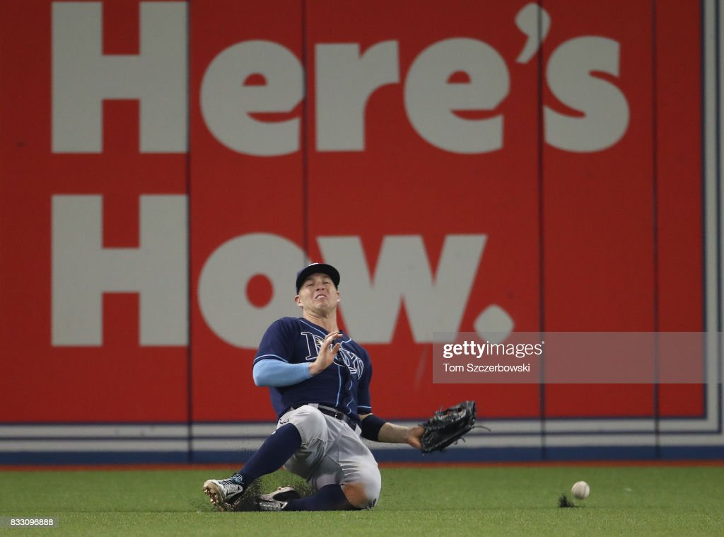 Corey Dickerson #34 of the Tampa Bay Rays slides on a fly ball off the bat of Steve Pearce of the Toronto Blue Jays that went for a double in the sixth inning during MLB game action at Rogers Centre on August 16, 2017 in Toronto, Canada.