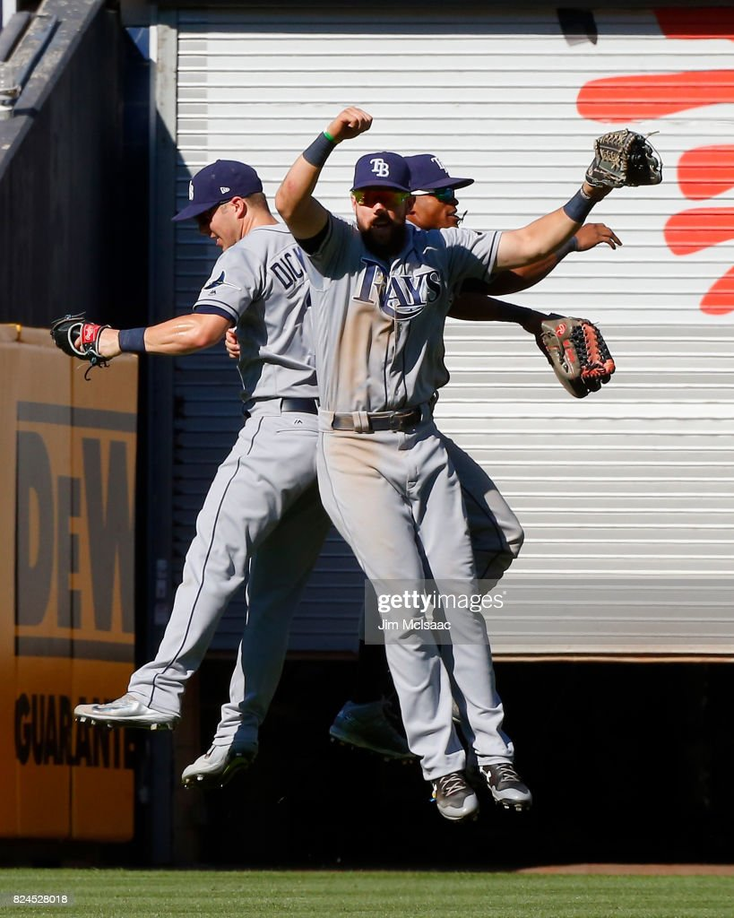 Corey Dickerson #10, Steven Souza Jr. #20 and Mallex Smith #0 of the Tampa Bay Rays celebrate after defeating the New York Yankees at Yankee Stadium on July 30, 2017 in the Bronx borough of New York City.