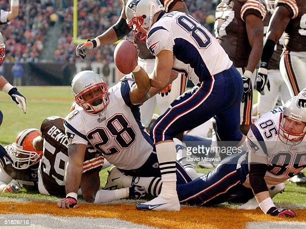 Corey Dillon of the New England Patriots celebrates his first quarter touchdown against the Cleveland Browns at Cleveland Browns Stadium December 5...