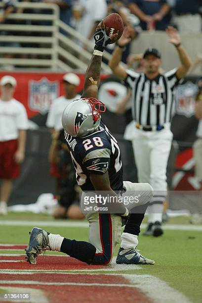 Corey Dillon of the New England Patriots celebrates his touchdown in the endfield during the game against the Arizona Cardinals at Sun Devil Stadium...