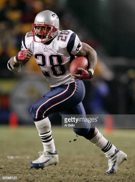 Corey Dillon of the New England Patriots runs with the ball in the AFC championship game against the Pittsburgh Steelers at Heinz Field on January...