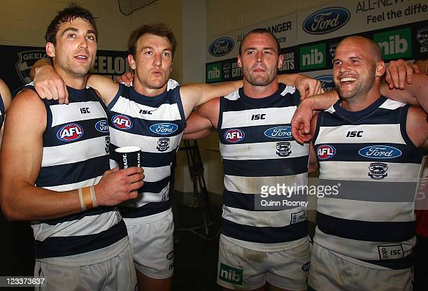 Corey Enright Darren Milburn Josh Hunt and Paul Chapman of the Cats sing the song in the rooms after winning the round 24 AFL match between the...