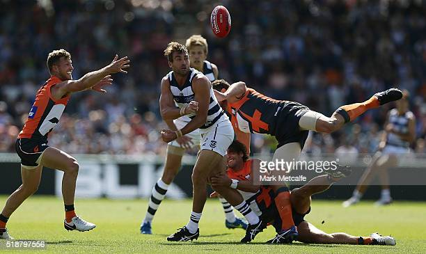 Corey Enright of the Cats handpasses the ball during the round two AFL match between the Greater Western Sydney Giants and the Geelong Cats at Star...