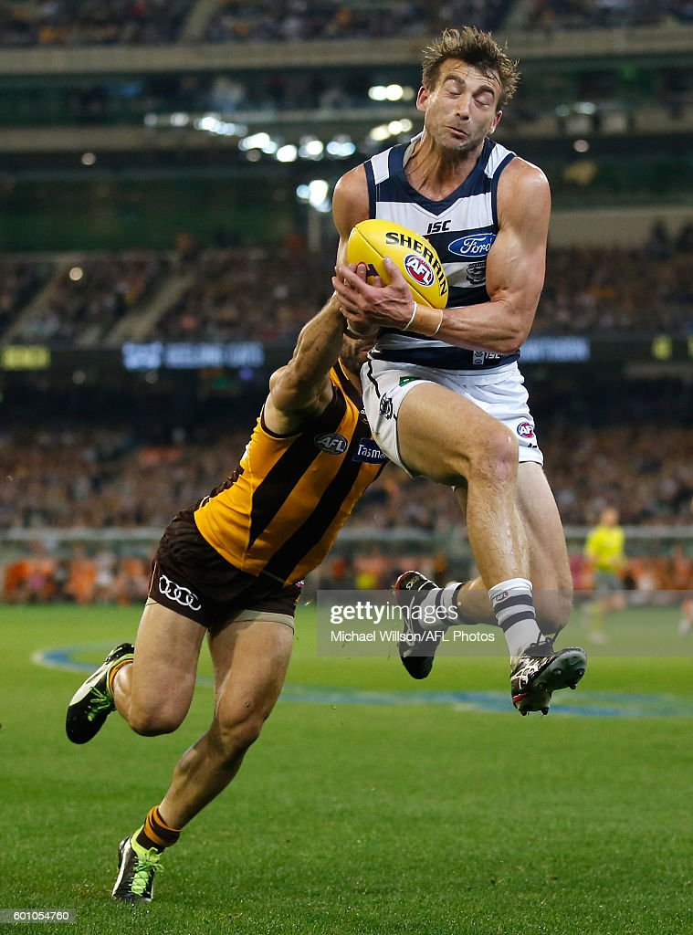 Corey Enright of the Cats marks ahead of Paul Puopolo of the Hawks during the 2016 AFL Second Qualifying Final match between the Geelong Cats and the Hawthorn Hawks at the Melbourne Cricket Ground on September 09, 2016 in Melbourne, Australia.