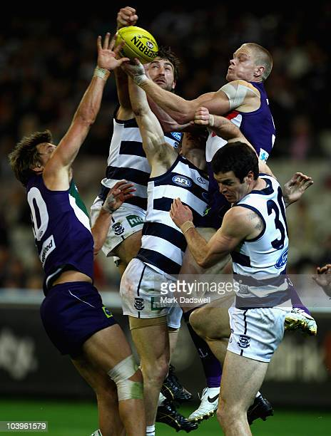 Corey Enright of the Cats punches the ball away from Adam McPhee of the Dockers during the AFL Second Semi Final match between the Geelong Cats and...