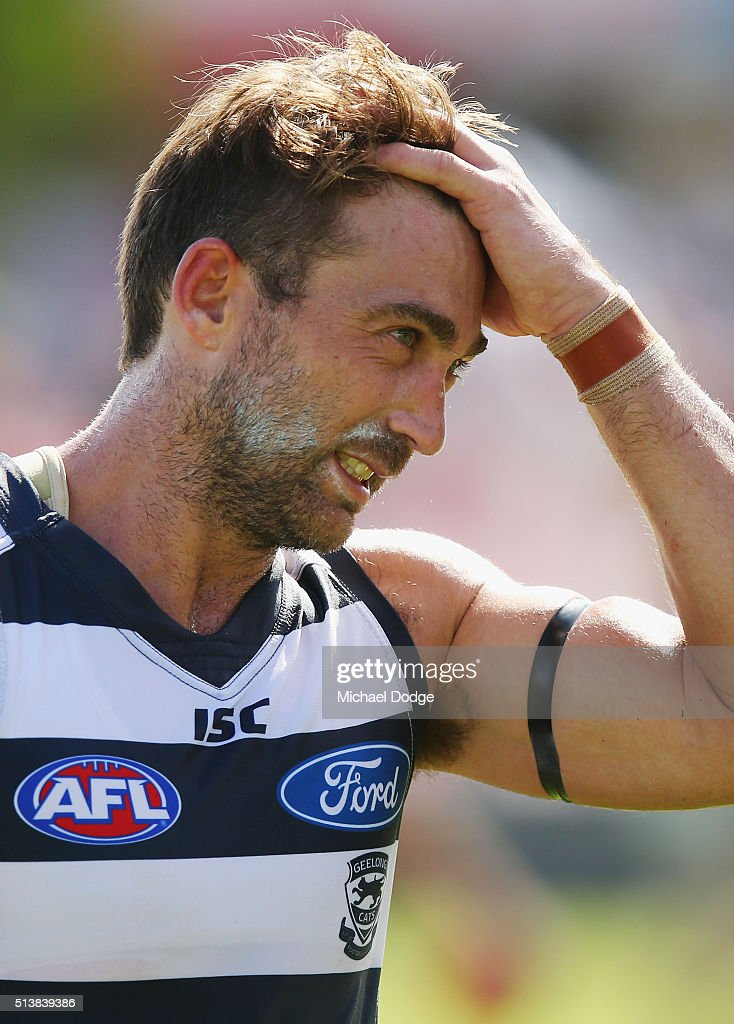 Corey Enright of the Cats walks off after the 2016 AFL NAB Challenge match between the Essendon Bombers and the Geelong Cats at Deakin Resserve on March 5, 2016 in Shepparton, Australia. He and teammates wore a black armband today for the death of Geelong Cats legend Paul Couch, a Brownlow Medallist for the club, who died this morning.