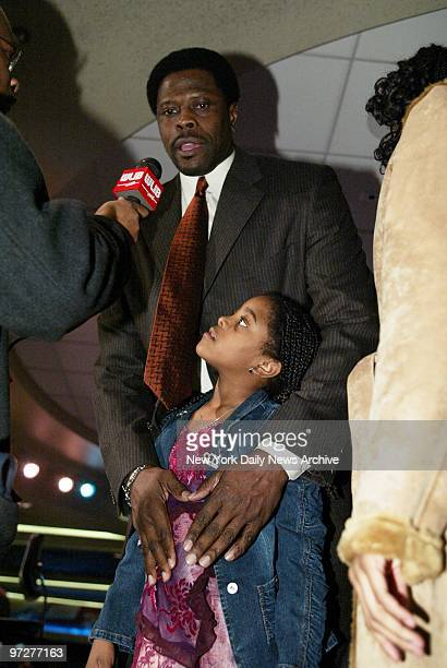 Corey Ewing looks on as her dad former New York Knick Patrick Ewing speaks to media during a news conference at the Theater in Madison Square Garden...