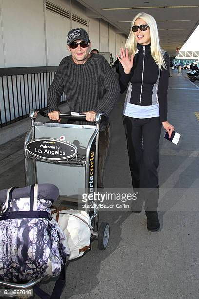 Corey Feldman and Courtney Anne Mitchell are seen at LAX on September 30 2016 in Los Angeles California
