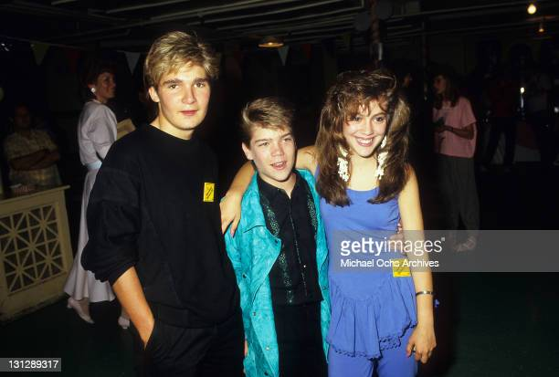 Corey Feldman and unidentified boy visit Alyssa Milano at production party for the television movie 'Crash Course' 1988
