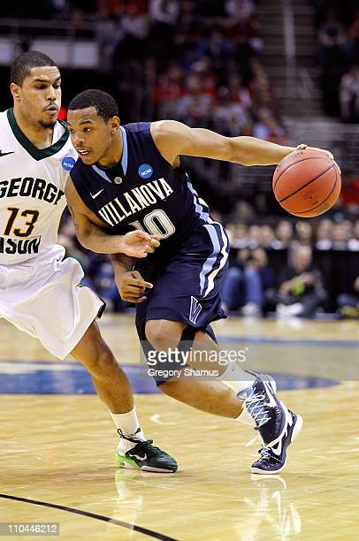 Corey Fisher of the Villanova Wildcats handles the ball against Isaiah Tate of the George Mason Patriots during the second round of the 2011 NCAA...