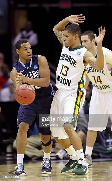 Corey Fisher of the Villanova Wildcats looks to pass around Isaiah Tate of the George Mason Patriots during the second round of the 2011 NCAA men's...
