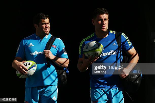 Corey Flynn and Kieron Fonotia of the Crusaders arrive at the Crusaders Super Rugby Grand Final Captain's Run at ANZ Stadium on August 1 2014 in...
