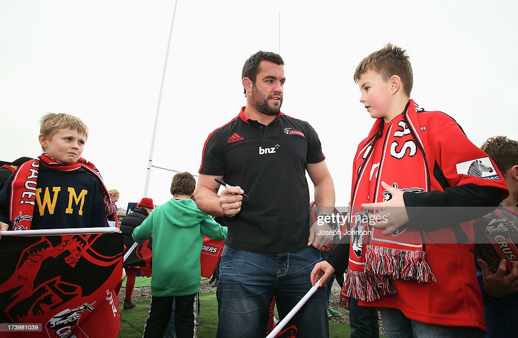 Corey Flynn of the Crusaders sign autographs after a media announcement that BNZ will be naming rights sponsor of the Crusaders on July 19, 2013 in Christchurch, New Zealand.