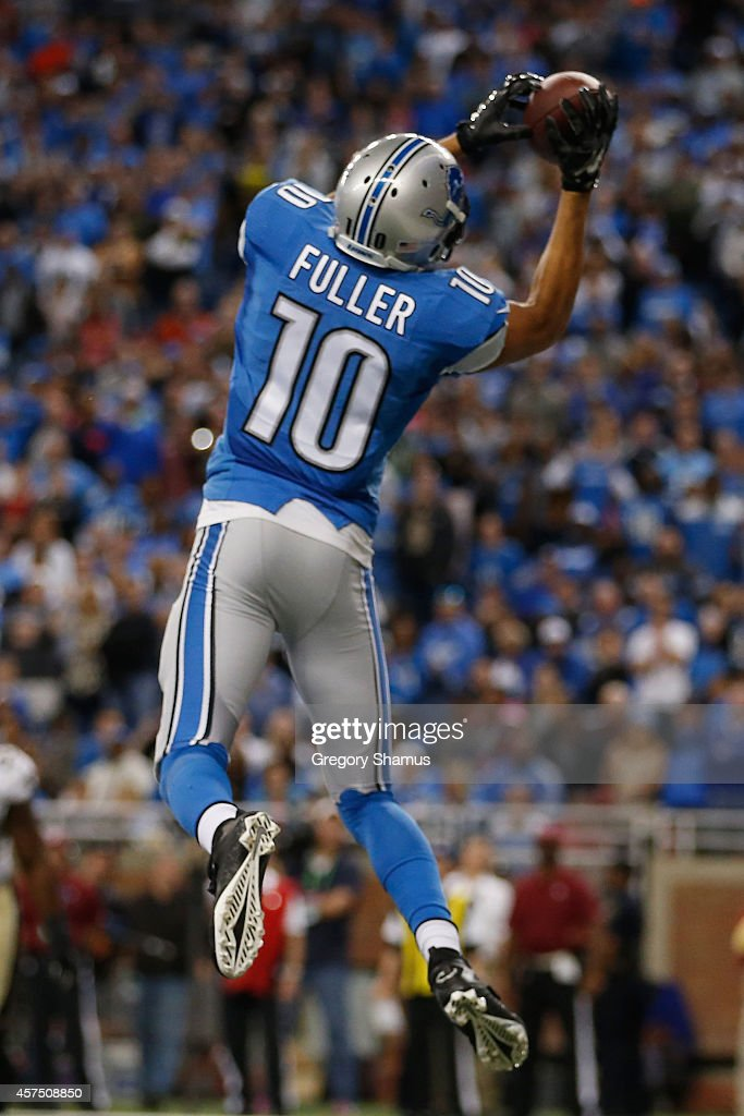 Corey Fuller #10 of the Detroit Lions catches a fourth quarter touchdown against the New Orleans Saints at Ford Field on October 19, 2014 in Detroit, Michigan.