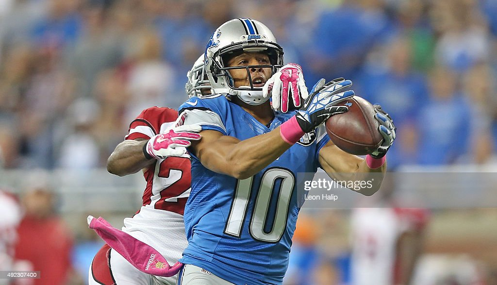 Corey Fuller #10 of the Detroit Lions makes a 48-yard reception against Jerraud Powers #25 of the Arizona Cardinals during the first quarter of the game on October 11, 2015 at Ford Field in Detroit, Michigan. The Cardinals defeated the Lions 42-17.