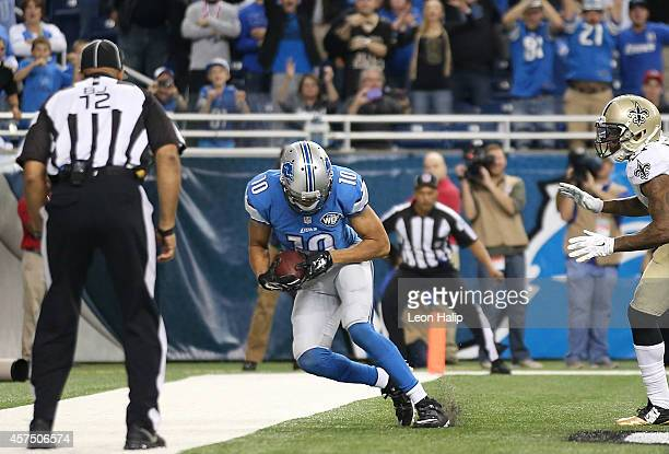 Corey Fuller of the Detroit Lions scores a late fourth quarter touchdown during the game against the New Orleans Saints at Ford Field on October 19...